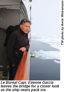 Le Boreal Capt. Etienne Garcia leaves the bridge for a closer look as the ship nears pack ice.