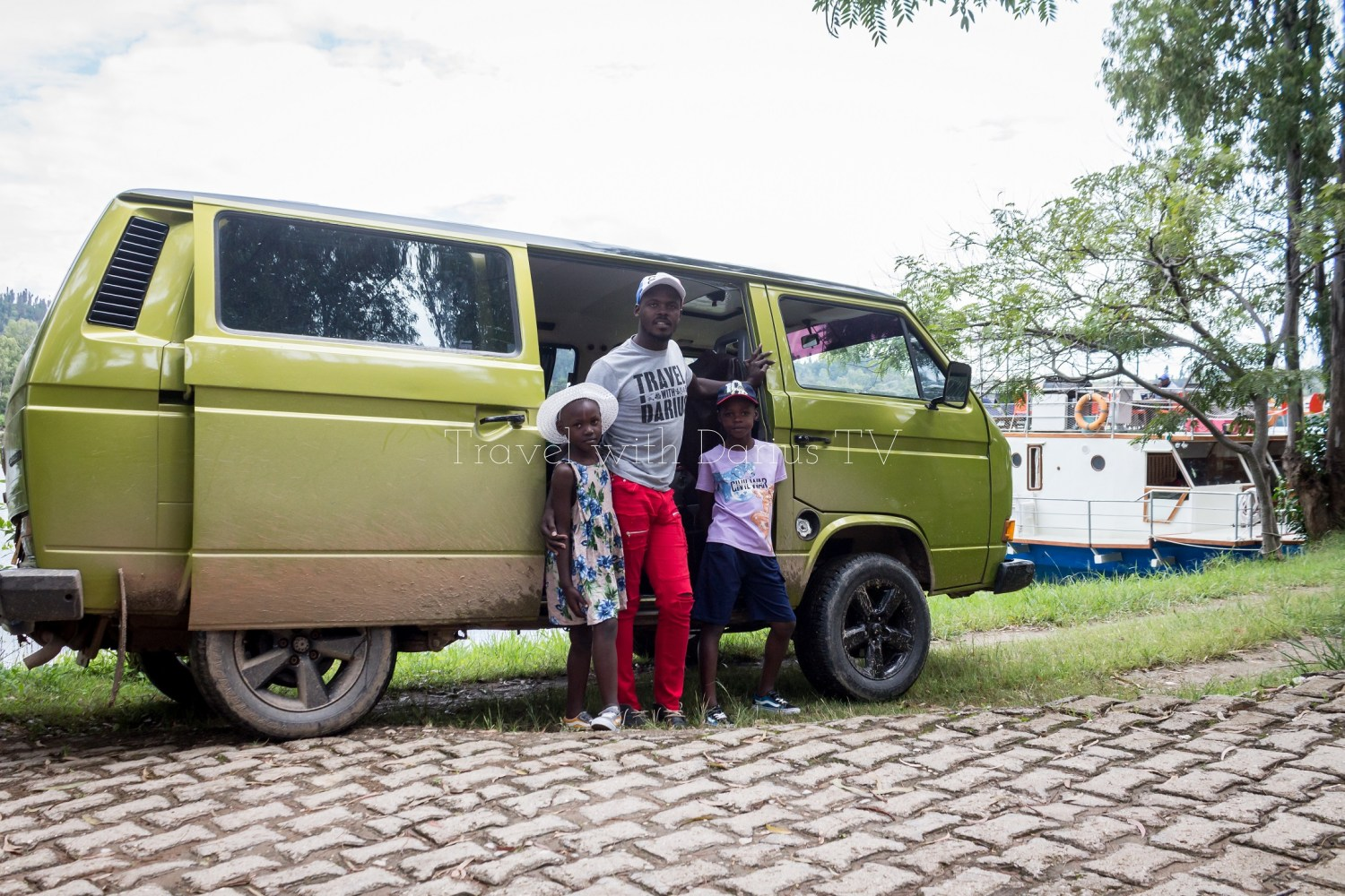 Darius pictured on a Lliza Shuttle to Kibuye with the kids dressed by Top Kids Kigali store.