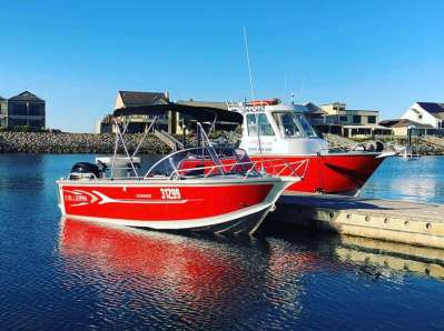 Two vessels available from BA Boat Hire Adelaide - the Bluefin Weekender and the Amara Centre Cab pictured side by side