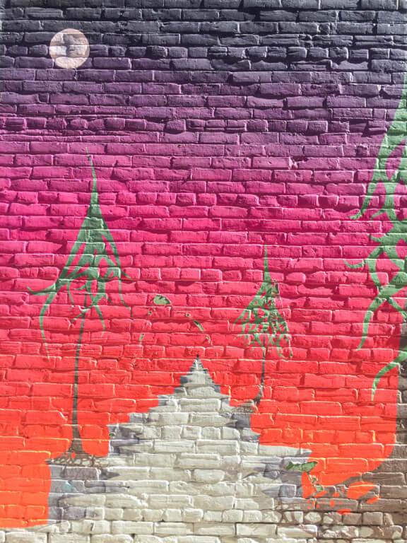 Fiery sky mural in Owen Sound's Alley Project mural walk