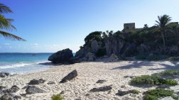Tulum sits on a cliff, overlooking the Caribbean Sea.