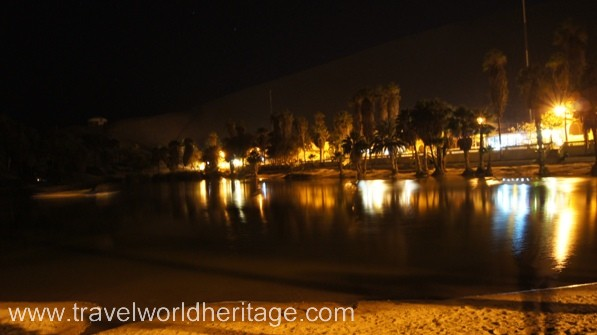 A ground view of Huacachina at night.