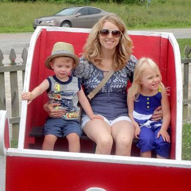 Family enjoying a sleigh ride in Santa Claus, Indiana