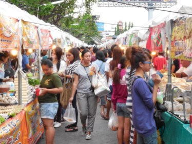 The crowds start early in their quest for something to eat at the Ramkhamhaeng Night Market.