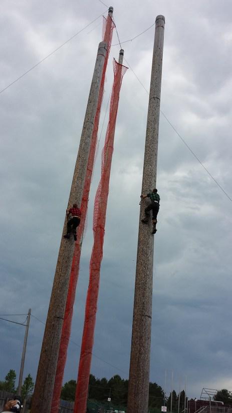 Lumberjacks climbing poles. Photo Credit: Linda Askomitis