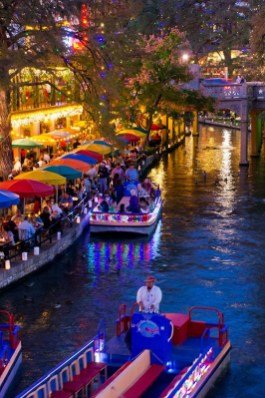 Colorful cascading holiday lights turn the River Walk into a fairyland. Photo Credit: VisitSanAntonio.com
