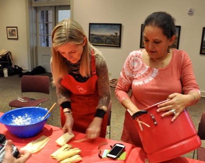 Putting the finishing touches on the tamales before placing them in the steamer. Photo Credit: Leslie Long