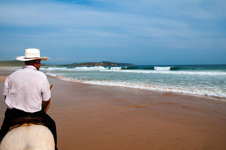 Horseback riding on pristine Soledad beach