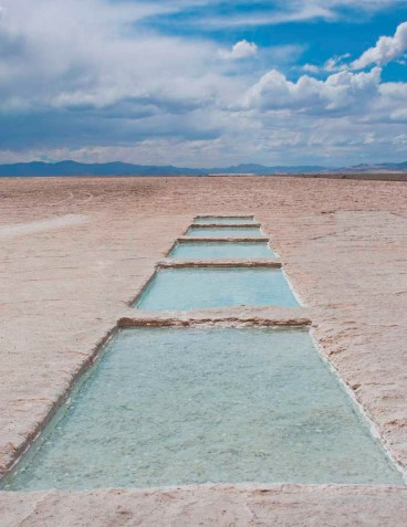Salt at Salinas Grandes is mined in rectangular slices the holes fill with salty water from the mountains and re-solidify
