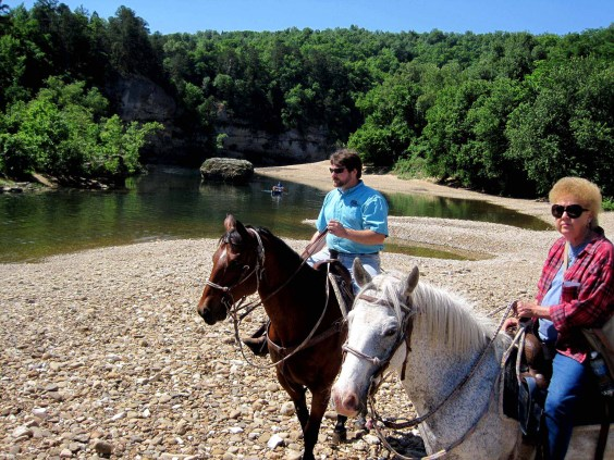 Ben Milburn, owner of Buffalo River Outfitters in St. Joe, Ark., enjoys riding horses along the Buffalo, as well as floating and fishing on it. Riding here with Barbara Gibbs Ostmann