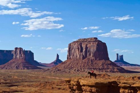 Monument Valley with Navajo man posing on horseback at John Ford?s Point; Monument Valley Navajo Tribal Park on the Utah-Arizona border.