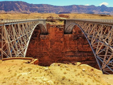 Navajo Bridge - The original historic steel arch bridge was constructed in 1929 and 66 years later was replaced by a more modern bridge that accommodates larger vehicles. The Navajo Bridge Interpretive Center anchors the two bridges on the west side of the canyon.