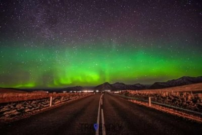Northern Lights in Iceland on a scenic road