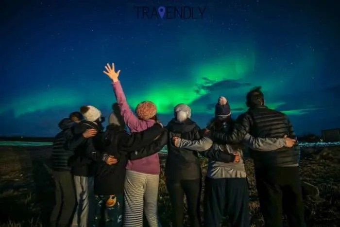 Hands up for the Northern Lights in Iceland