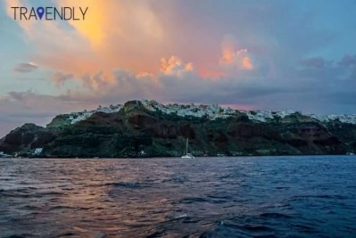 View of Oia under the sunset from our catamaran