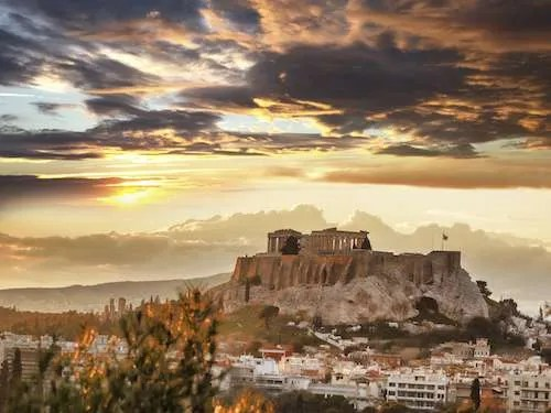 Fire sunset over Acropolis Athens Greece