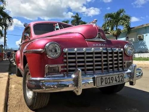 Classic pink car in Havana Cuba