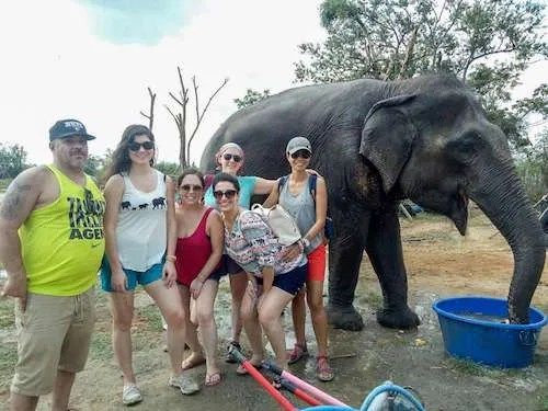 Thailand group tour elephant hug