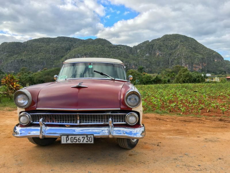 Old classic car on a farm in Vinales