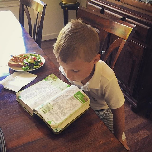 Hmm...lunch or the Bible? Good call, Obadiah! He's wanting to teach me what he learned in Gospel Groups today. #church+home #familyministry #itsreallyhappening