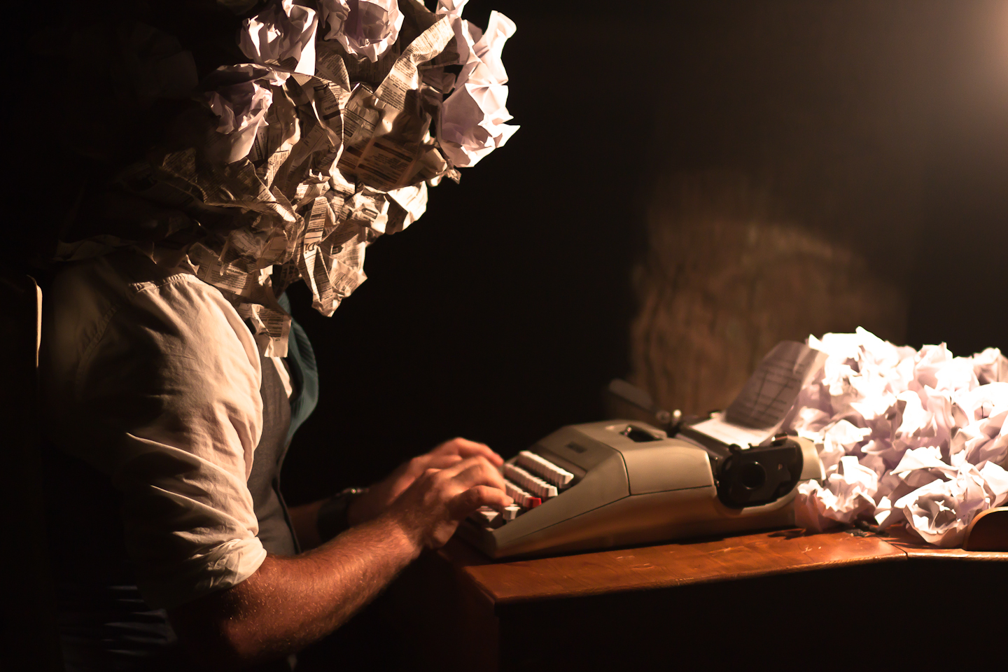 Typist with a crumpled paper head