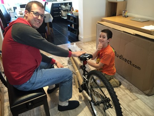 Grant and I assembling his 11th birthday present - a new bike!