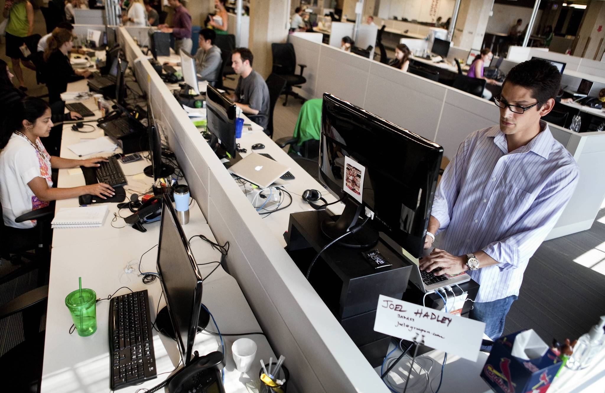 Sedentary office workers try standing desks  Chicago Tribune