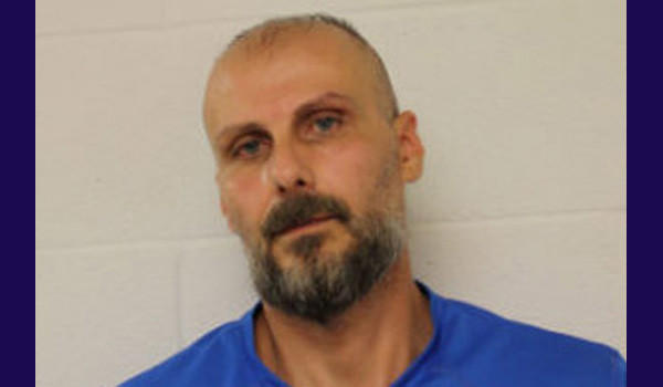 Tom Diamond, 45, has been charged with a hate crime after police say he threatened a woman, yelled racial slurs and epithets at her, and chased her toward the hospital where she works.