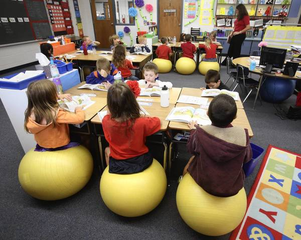 ball chairs for students folding chair with wheels lake teacher uses exercise balls to control wiggles tribunedigital orlandosentinel