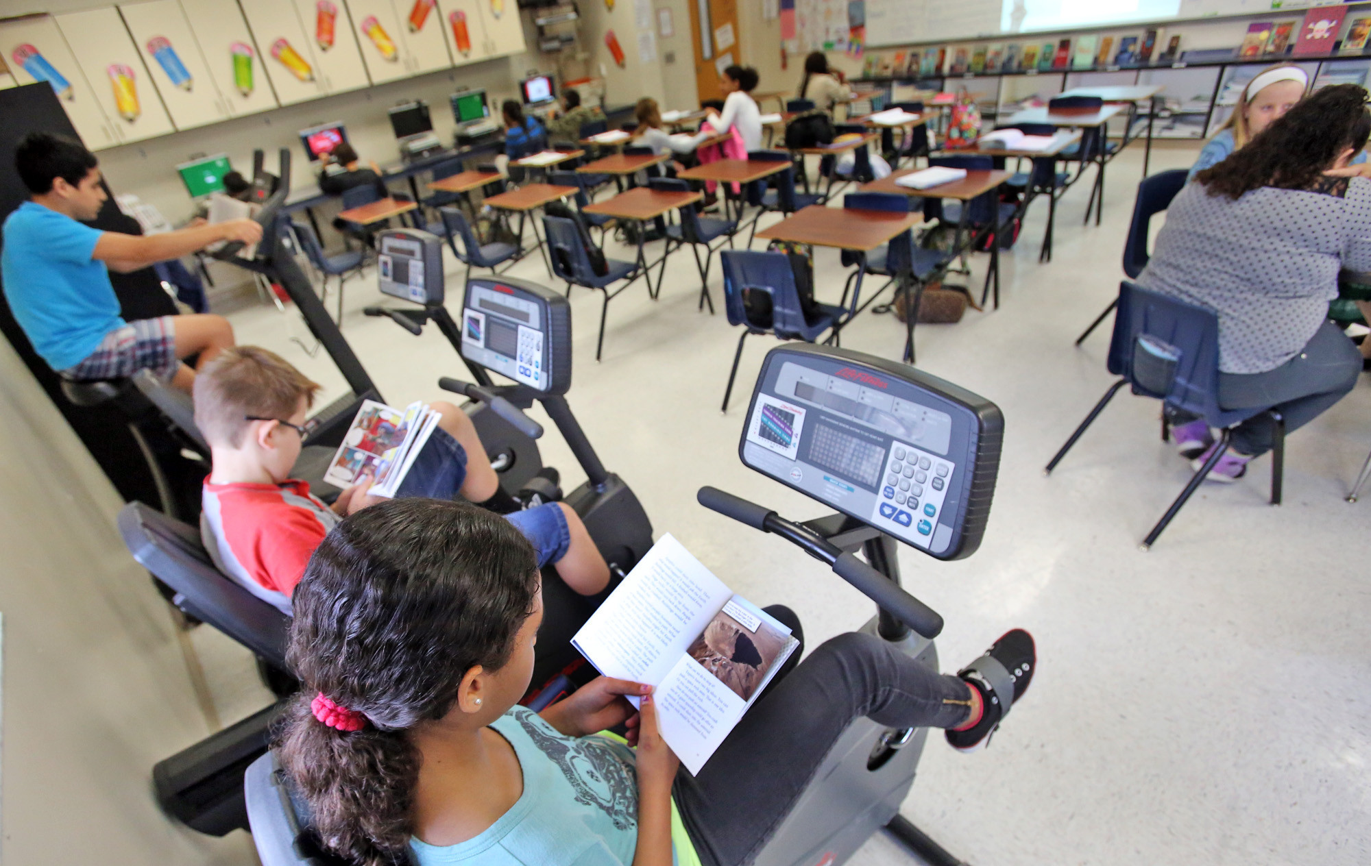 Exercise bikes in classroom help turn riders into readers