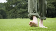 Men Walking Barefoot On Grass