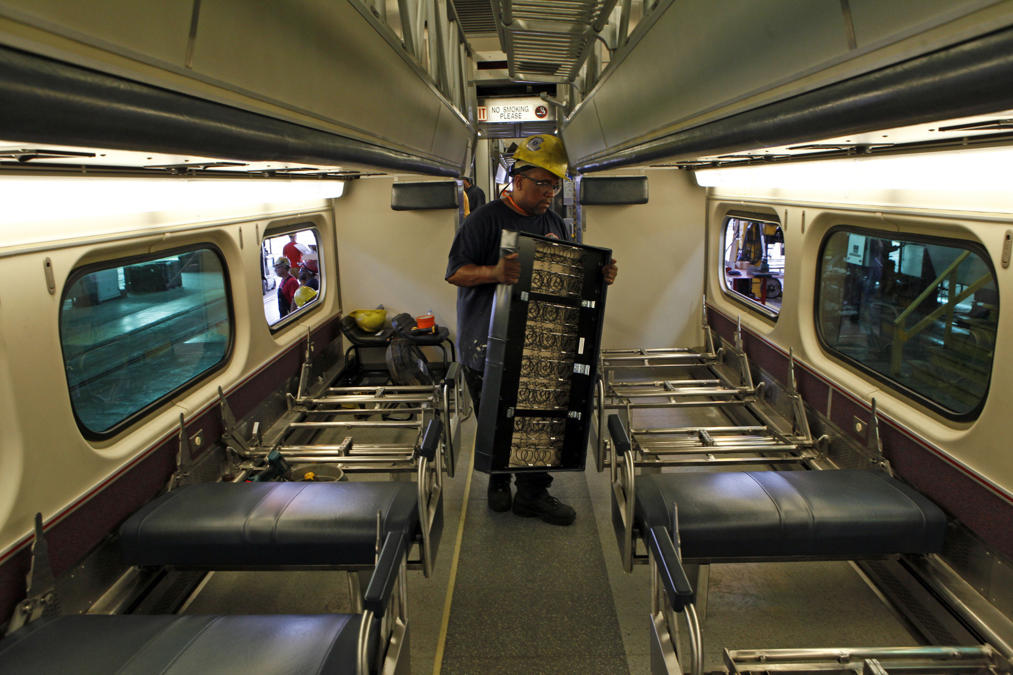 Metra refitting cars with power outlets new toilets