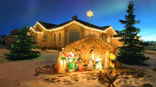 Outdoor Christmas Nativity scene with Northern lights overhead. Alberta, Canada