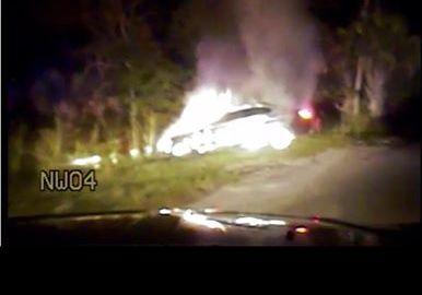 Deputy saves man from burning car