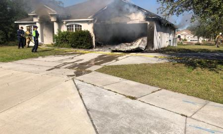 Fire crews battle house fire in Port St. Lucie