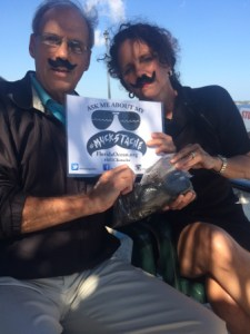 """Mark Perry and I display our """"muckstaches"""" for Florida Oceanographics fundraiser/awareness raiser, 2015."""