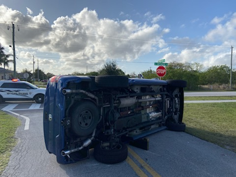 Rollover crash at NW Bayshore Blvd/NW Treemont Ave; drivers sustained non-life-threatening injuries
