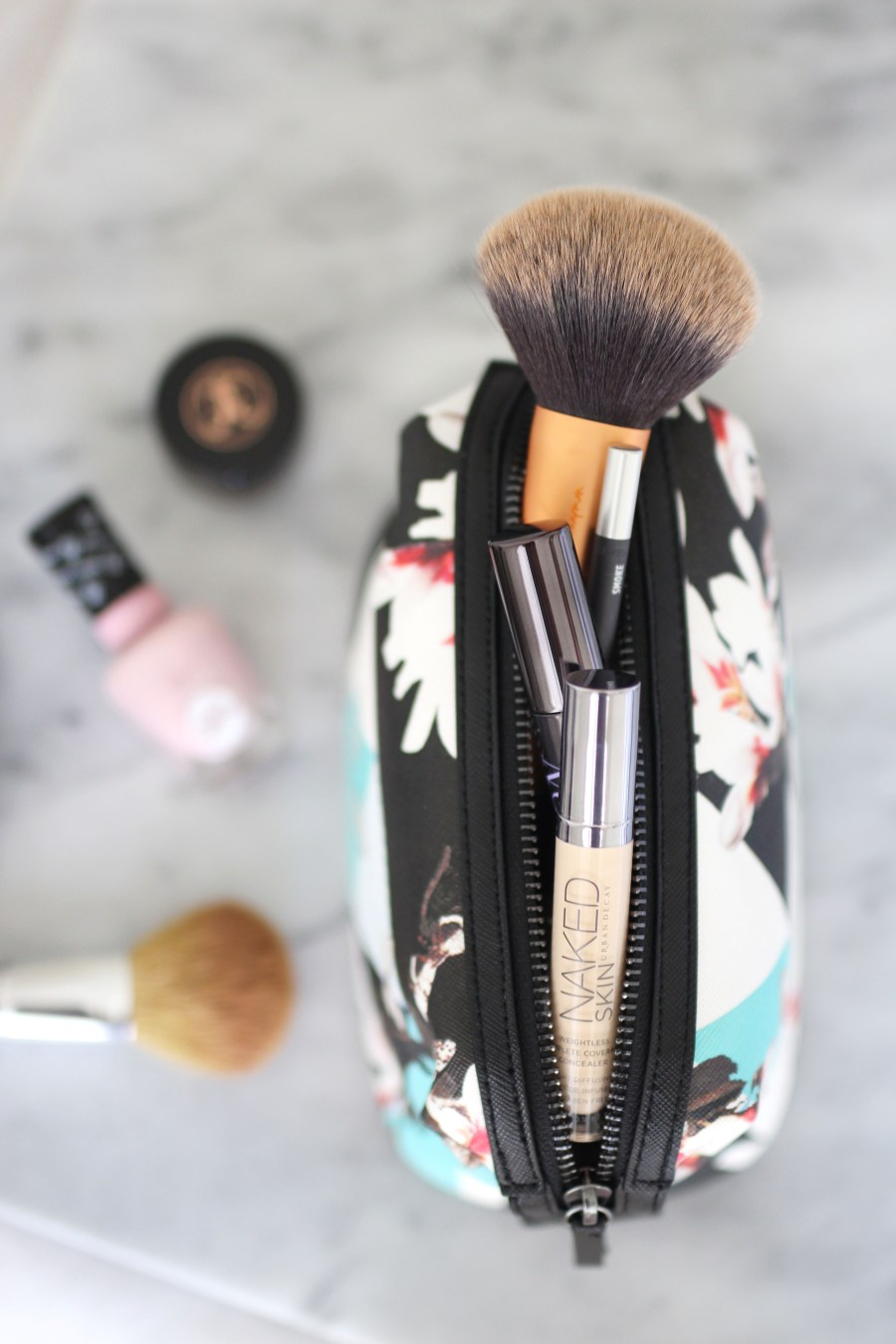 what's in my travel makeup bag, travel makeup must-haves, beauty products, lifestyle blog, Treats and Trends, cute cosmetic bag