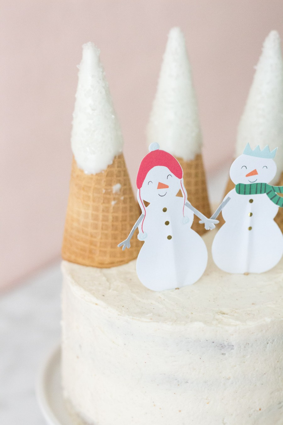 Eggnog Cake with Snowmen and ice cream cone Mountains