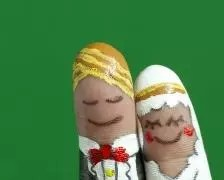 A picture of fingerpainted wedding couple by Freedigitalphotos.net/10incheslab
