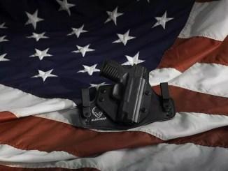 handgun and flag by Ibropalic
