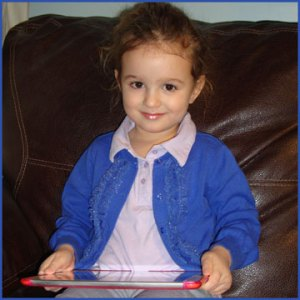 preschool girl on iPad