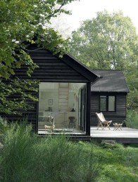 A Wooden House That's Simple On The Outside But Modern On The Inside 39