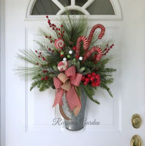 Adorable Front Door Christmas Decoration Ideas That Trend This Year 45