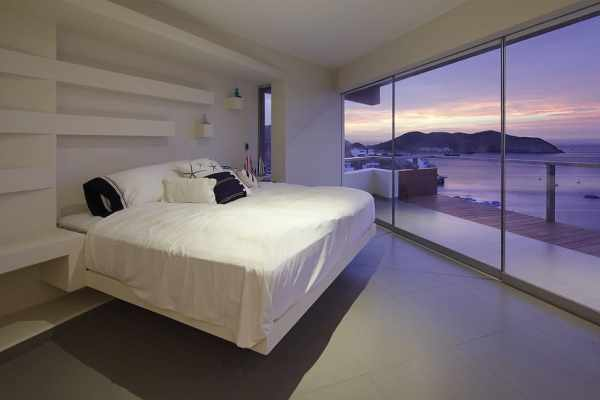 modern bedroom with ocean view Rock Cliff Exposed Inside Ocean View Home | Modern House Designs