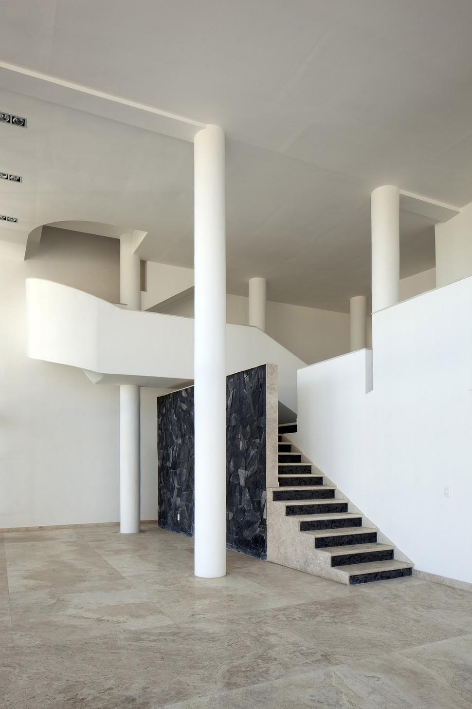 Modern Hacienda Style Home Built on Pillars  Modern House Designs