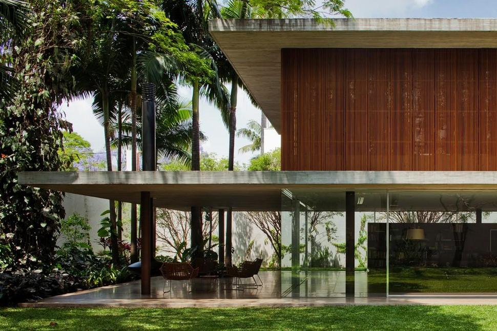 house design long glass house with folding wooden facade l