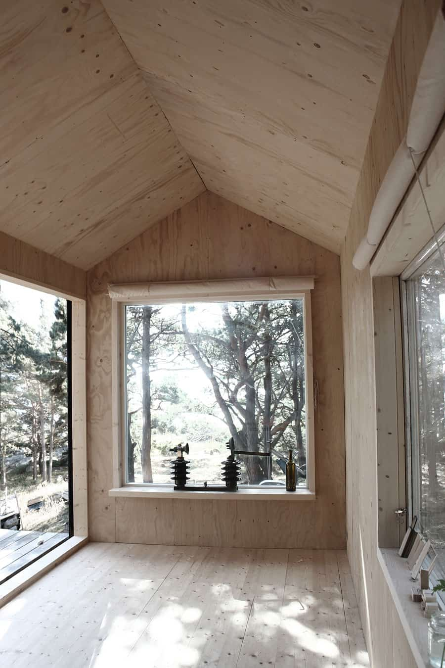 Compact Plywood And Pine Cabin With Attached Sauna