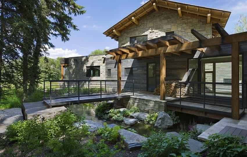 Contemporary Stone Farmhouse With Aged Wood Siding