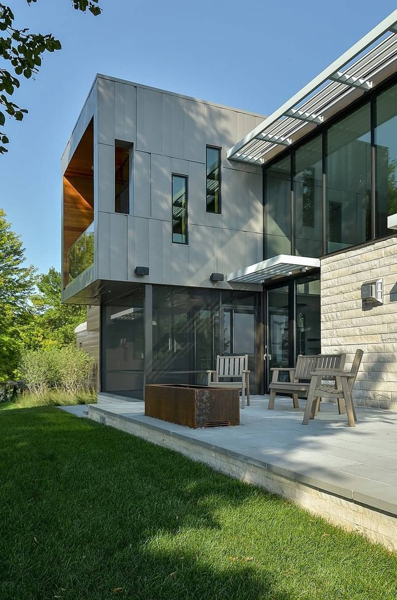 Glass Lake House Features Modern Silhouette of Earthy Materials  Modern House Designs